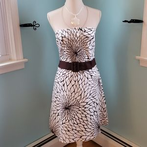 Strapless white and brown flower patterned dress.